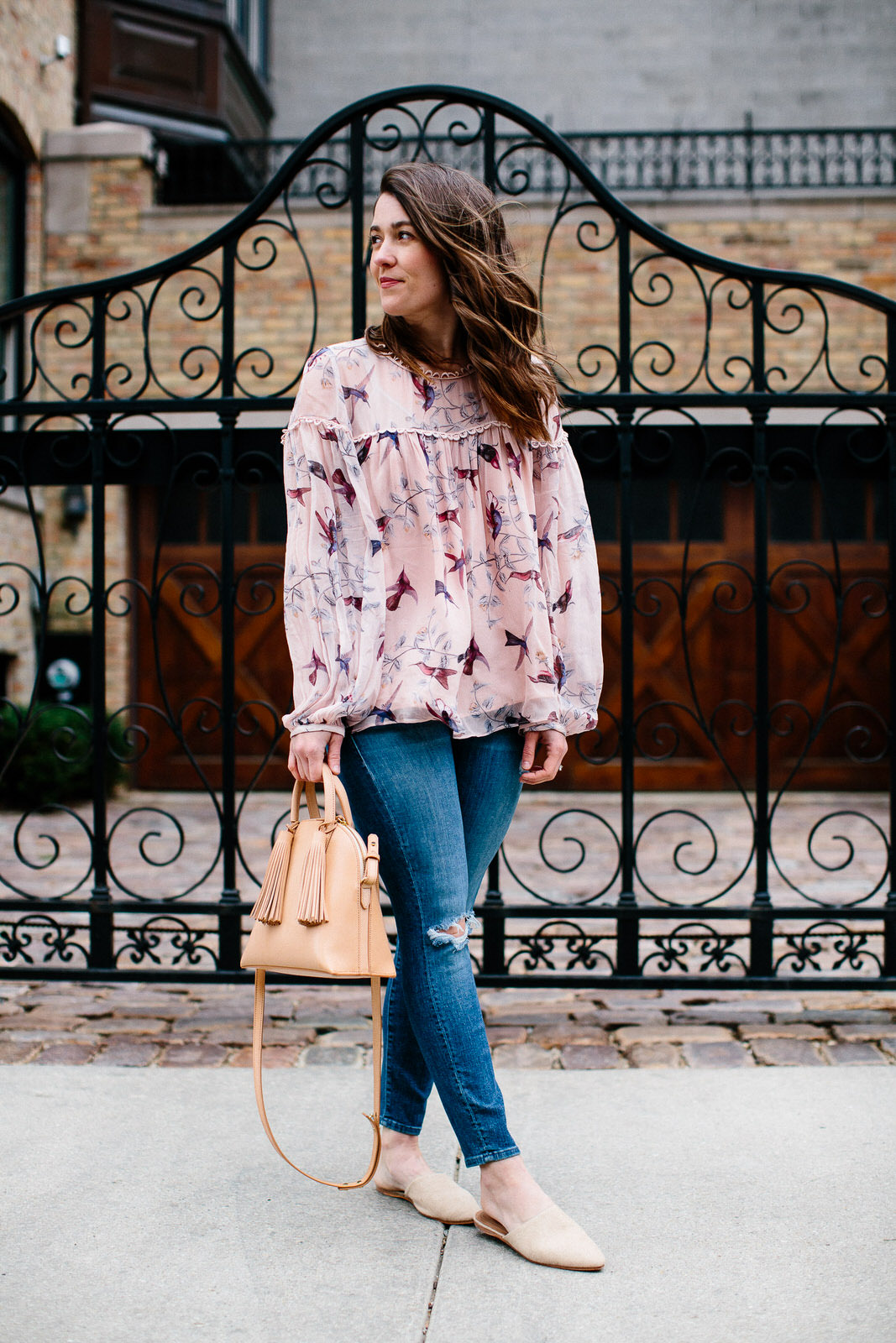 Liz Adams of Sequins & Stripes styles an easy spring blouse to transition to warmer weather.