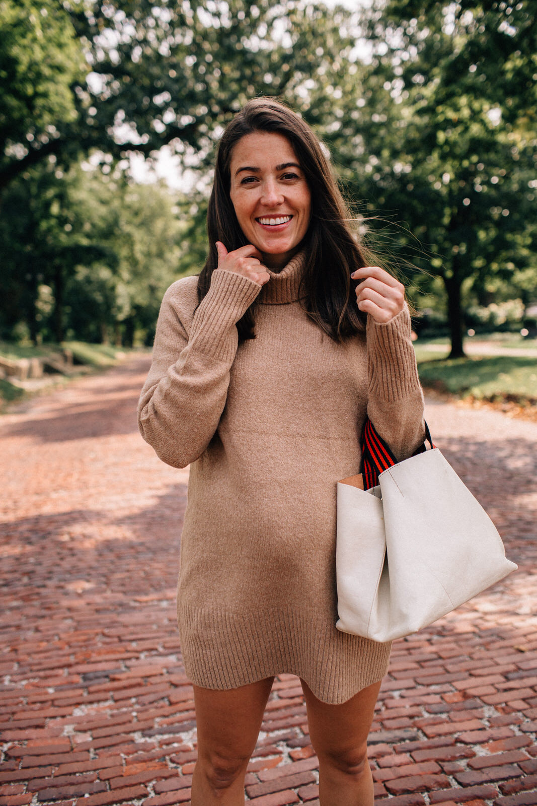 Liz Adams wearing sweater dress for fall from Amazon with Clare V. leather tote and Golden Goose sneakers how to style sweater dresses for fall